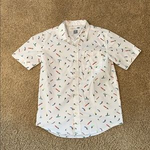 White button up short with surfers on it